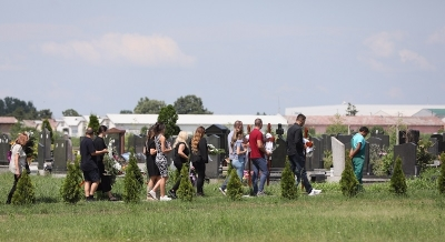 The burial of three people killed in Surcin